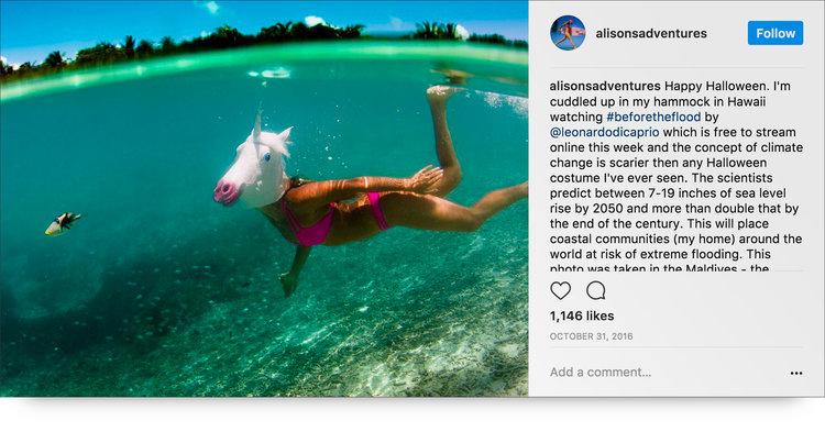 Instagram post from @alisonsadventures swimming  underwater wearing a unicorn head