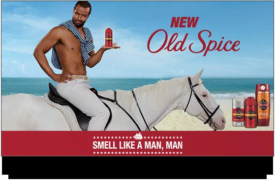 Old Spice man sitting on white horse shirtless