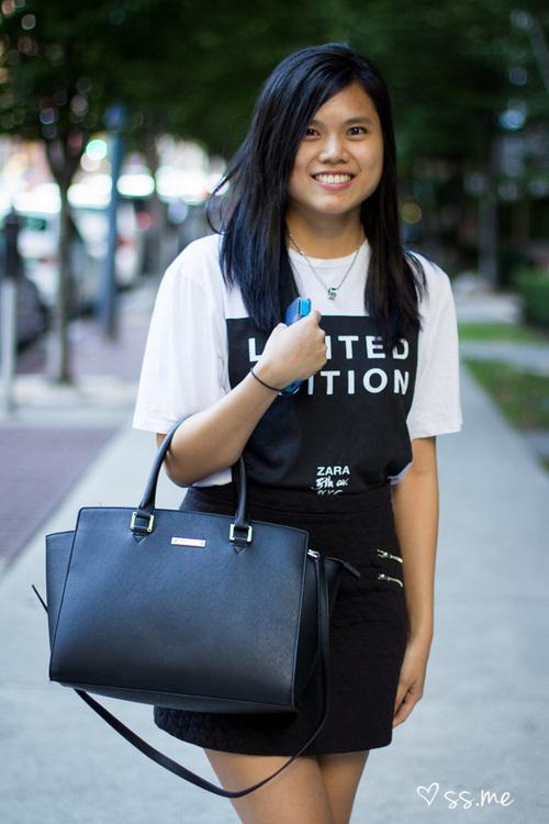 photo of woman in tshirt holding black handbag - fashion affliate network