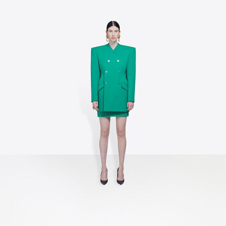 woman wearing green Balenciaga blazer and skirt .jpg